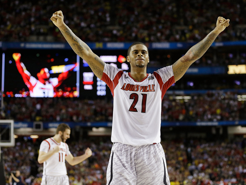 Description of . Louisville forward Chane Behanan (21) reacts after defeating Michigan after the second half of the NCAA Final Four tournament college basketball championship game Monday, April 8, 2013, in Atlanta. Louisville won 82-76. (AP Photo/David J. Phillip)