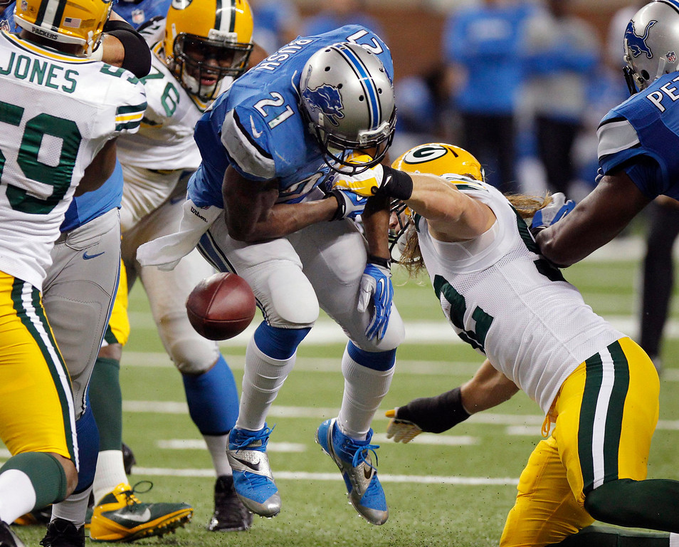 . Detroit Lions running back Reggie Bush (21) fumbles during the first quarter of an NFL football game against the Green Bay Packers at Ford Field in Detroit, Thursday, Nov. 28, 2013. (AP Photo/Duane Burleson)