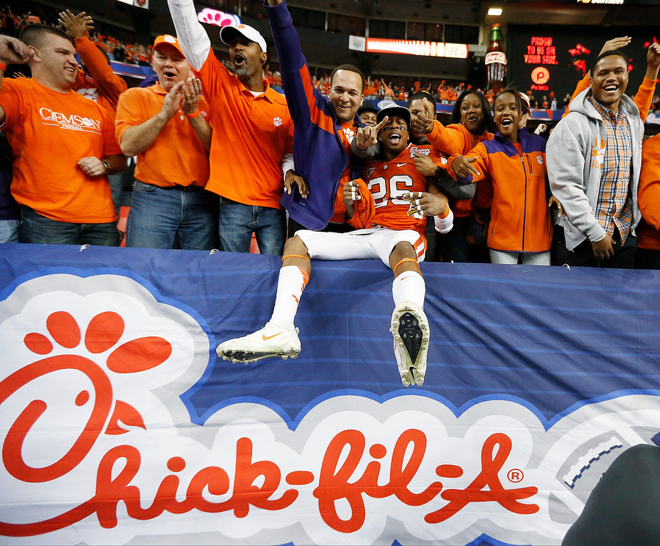 . Clemson defensive back Garry Peters (26) celebrates with fans after the Chick-fil-A Bowl NCAA college football game against LSU, Monday, Dec. 31, 2012, in Atlanta. Clemson won 25-24. (AP Photo/John Bazemore)