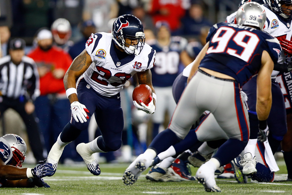 Description of . FOXBORO, MA - DECEMBER 10:  Running back Arian Foster #23 of the Houston Texans runs the ball in the first half against the New England Patriots at Gillette Stadium on December 10, 2012 in Foxboro, Massachusetts.  (Photo by Jared Wickerham/Getty Images)
