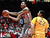 New Mexico's Kendal Williams tries for a layup as he goes past Wyoming's Larry Gilmore Jr. during the first half of an NCAA college basketball game in Albuquerque, N.M., Saturday, March 2, 2013. (AP Photo/Craig Fritz)