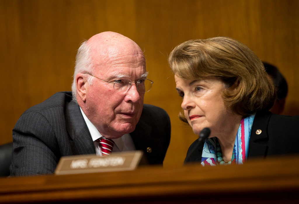 Description of . Senate Judiciary Committee Chairman Sen. Patrick Leahy, D-Vt., left, talks with Sen. Dianne Feinstein, D-Calif., on Capitol Hill in Washington, Wednesday, Oct. 2, 2013, during the committee's oversight hearing on the Foreign Intelligence Surveillance Act. U.S. intelligence officials say the government shutdown is seriously damaging the intelligence community's ability to guard against threats. (AP Photo/ Evan Vucci)
