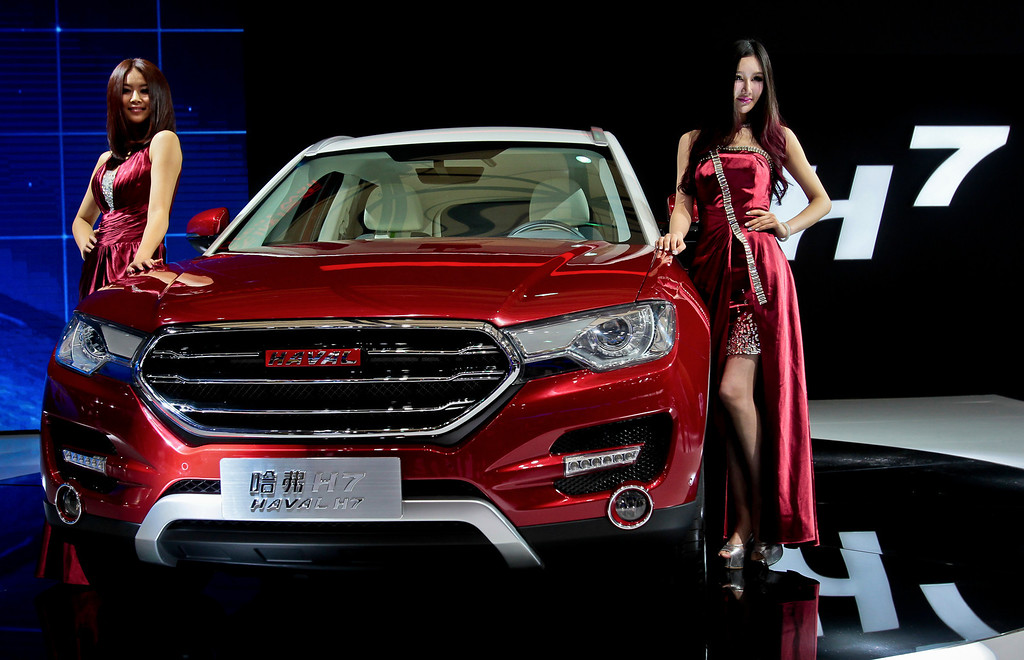 Description of . Chinese models pose with Great Wall H7 SUV after its unveiled at the Shanghai International Automobile Industry Exhibition (AUTO Shanghai) media day in Shanghai Saturday, April 20, 2013. (AP Photo)