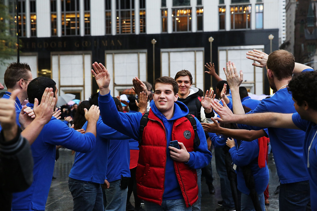 Description of . Some of the first customers in line walk into the Apple Store to purchase the new iPad Air, the fifth generation of its tablet on November 1, 2013 in New York City.  (Photo by Spencer Platt/Getty Images)