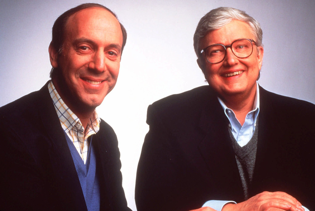 Description of . Film critics Gene Siskel, left, and Roger Ebert are shown in a 1994 photo. (AP Photo/Buena Vista Television)