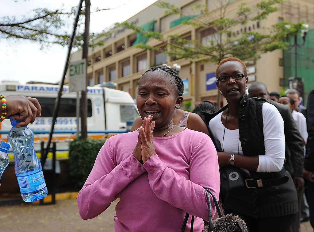 Description of . A woman who had been held hostage reacts following a security operation at an upmarket shopping mall, where suspected terrorists engaged Kenyan security forces in a drawn out gun fight on September 21 2013 in Nairobi. Some 20 people have been killed and about 50 wounded Saturday in the initial attack by the gunmen the Kenya Red Cross said. AFP PHOTO/Tony  KARUMBA/AFP/Getty Images