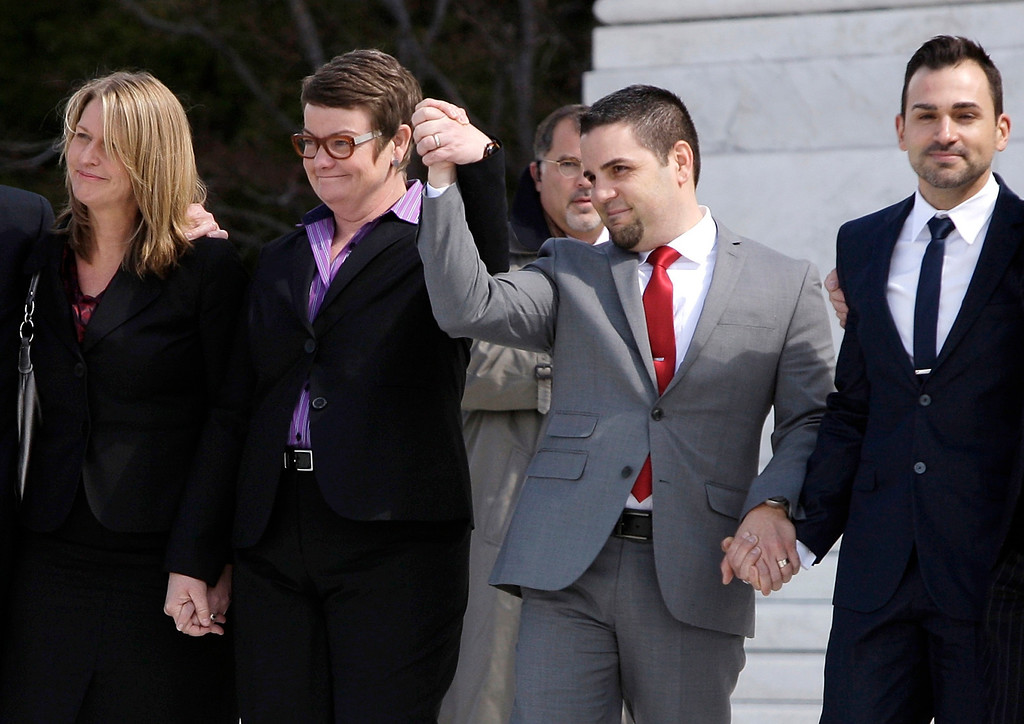 Description of . Plaintiffs Sandra Stier (L to R), Kristin Perry, Jeff Zarrillo and Paul Katami exit from the Supreme Court holding hands after their case against California\'s Proposition 8 was argued in Washington, March 26, 2013.  REUTERS/Jonathan Ernst