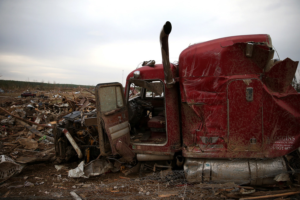 Description of . The remains of a large truck destroyed by a tornado on Sunday evening rests amid the debris, on April 29, 2014 in Vilonia, Arkansas.   (Photo by Mark Wilson/Getty Images)