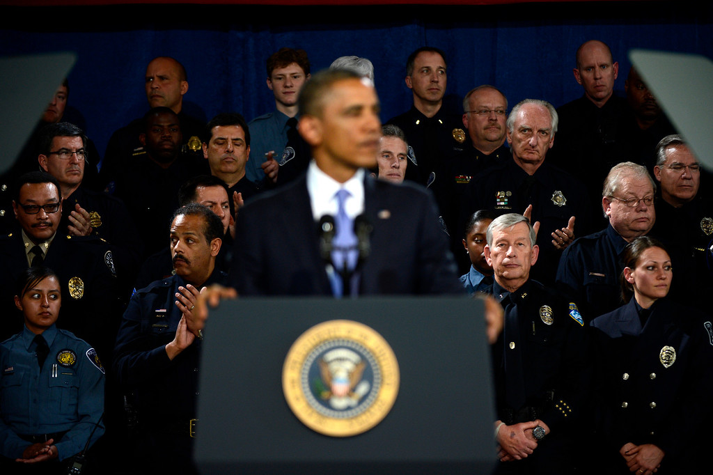 Description of . DENVER, CO. - APRIL 03: Officers clap as President Barack Obama speaks to uniformed officers and community leaders at the Denver Police Academy calling for Congress to act more like the state's Democratic-controlled legislature to pass stronger gun-control laws. (Photo By Joe Amon/The Denver Post)
