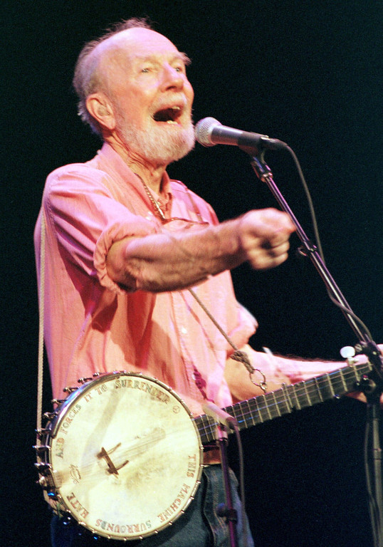 Description of . Legendary folk singer Pete Seeger urges the audience to participate during a benefit at the Calvin Theater in Northampton, Mass., Saturday evening, Sept. 9, 2000, for therapist Eduardo M. Bustamente, a specialist in treating troubled adolescents. Bustamante was forced by the state Board of Registration of Psychology to halt his Amherst, Mass., practice on Sept. 2. The decision came following allegations that in 1997, Bustamante made sexual advances to girl, then 18, in his care. (AP Photo/Nancy Palmieri)
