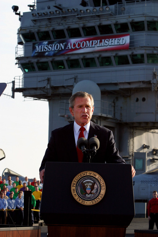 Description of . President Bush declares the end of major combat in Iraq on May 1, 2003 as he spoke aboard the aircraft carrier USS Abraham Lincoln off the California coast. (AP Photo/J. Scott Applewhite)