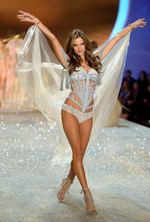 Description of . Model Alessandra Ambrosio walks the runway at the 2013 Victoria's Secret Fashion Show at Lexington Avenue Armory on November 13, 2013 in New York City.  (Photo by Dimitrios Kambouris/Getty Images for Victoria's Secret)