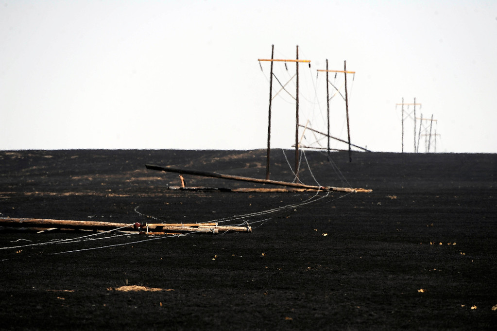 Description of . Power lines are down along Highway 71 near Last Chance, Colorado as a result of the Last Chance Fire that scorched over 45,000 acres, burning several homes and many out buildings. Andy Cross, The Denver Post