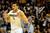 Denver Nuggets small forward Danilo Gallinari (8) pops his jersey after hitting a three pointer over Los Angeles Lakers shooting guard Kobe Bryant (24) during the second half of the Nuggets' 126-114 win at the Pepsi Center on Wednesday, December 26, 2012. AAron Ontiveroz, The Denver Post