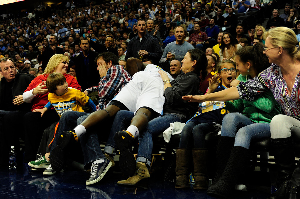 Description of . Denver Nuggets small forward Kenneth Faried (35) flies into the first row while chasing a loose ball against the Los Angeles Lakers during the first half at the Pepsi Center on Wednesday, December 26, 2012. AAron Ontiveroz, The Denver Post