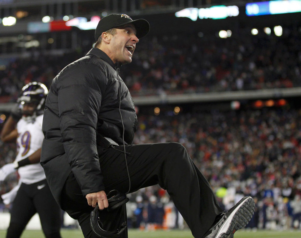 Description of . Baltimore Ravens head coach John Harbaugh argues that New England Patriots quarterback Tom Brady kicked his player as he slid to the turf on a first half run during the NFL AFC Championship football game in Foxborough, Massachusetts, January 20, 2013. REUTERS/Adam Hunger