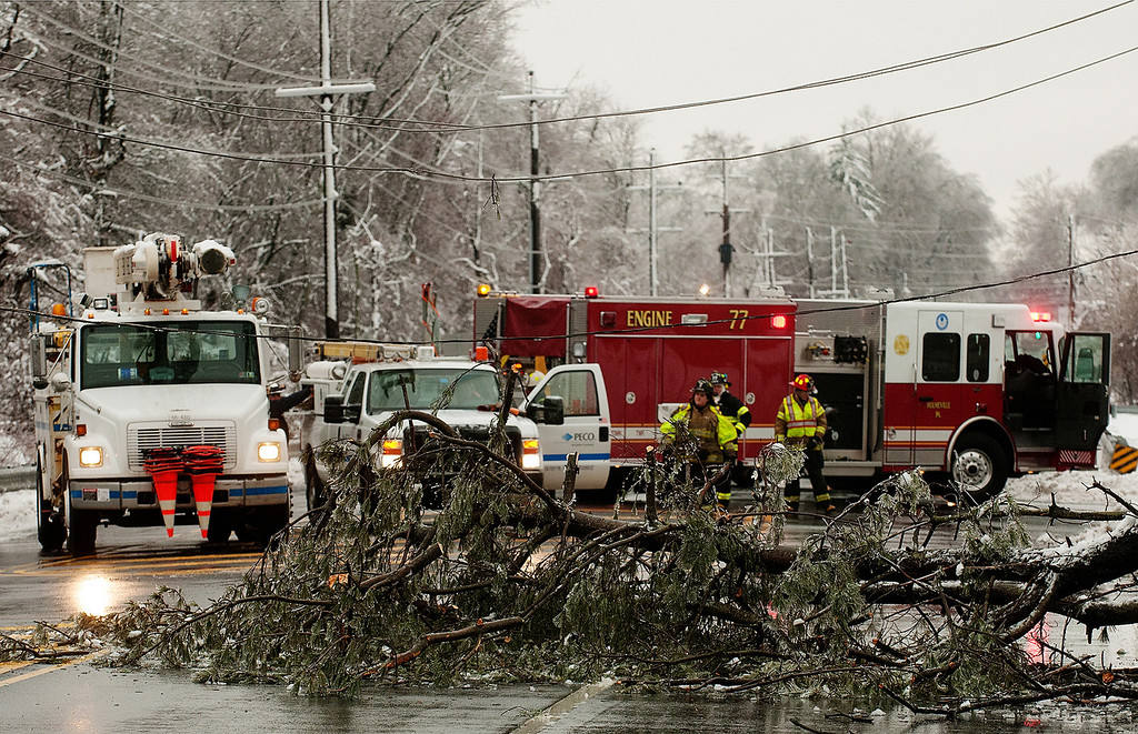 Description of . Emergency personnel prepare to clear a fallen tree from Trenton Road in Middletown Township near Levittown, Pa., Wednesday morning, Feb. 5, 2014. Wednesday knocked out power to more than 560,000 electric customers in eastern and central Pennsylvania and prompted school closures, legislative delays and speed reductions on major roadways. (AP Photo/Bucks County Courier Times, Bill Fraser)