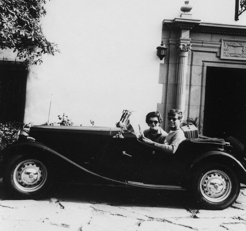 Description of . The newlyweds sit in a convertible while on their honeymoon in Acapulco, Mexico, in September 1953.