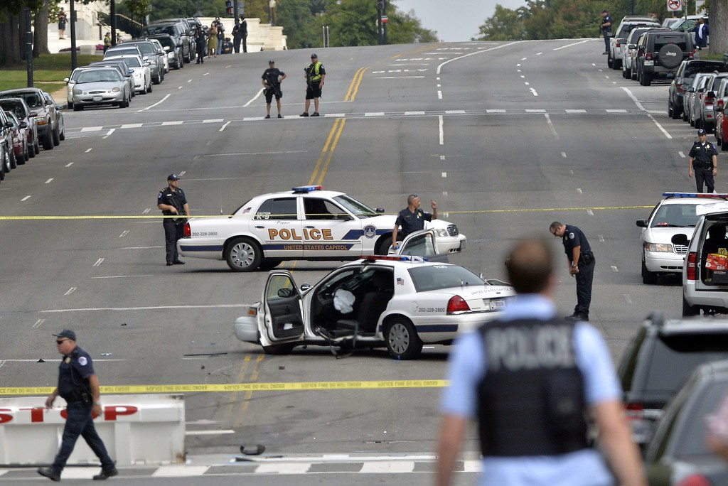 Description of . A police cruiser is wrecked after shots fired were reported near 2nd Street NW and Constitution Avenue on Capitol Hill in Washington, DC, on October 3, 2013.  The US Capitol was placed on security lockdown Thursday after shots were fired outside the complex, senators said.