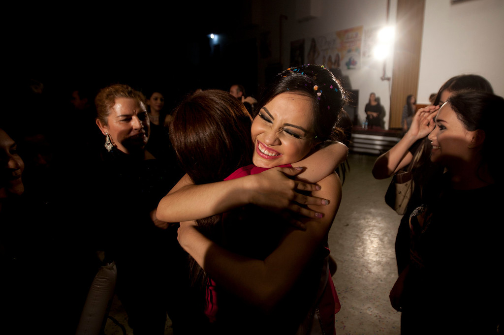 Description of . In this Jan. 26, 2013 photo, Magdabelyn Parra Gamez, who goes by Belyn, is embraced by a friend after winning the beauty pageant