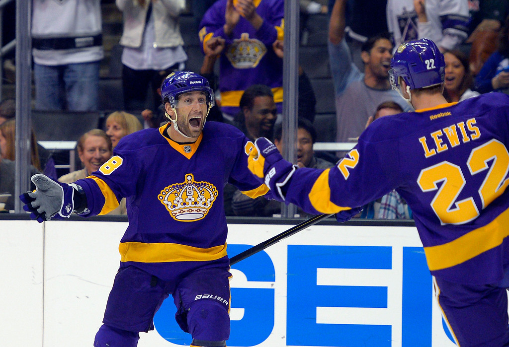 Description of . Los Angeles Kings center Jarret Stoll, left, celebrates a goal by center Trevor Lewis, right, during the second period of their NHL hockey game against the Colorado Avalanche, Saturday, Feb. 23, 2013, in Los Angeles. (AP Photo/Mark J. Terrill)
