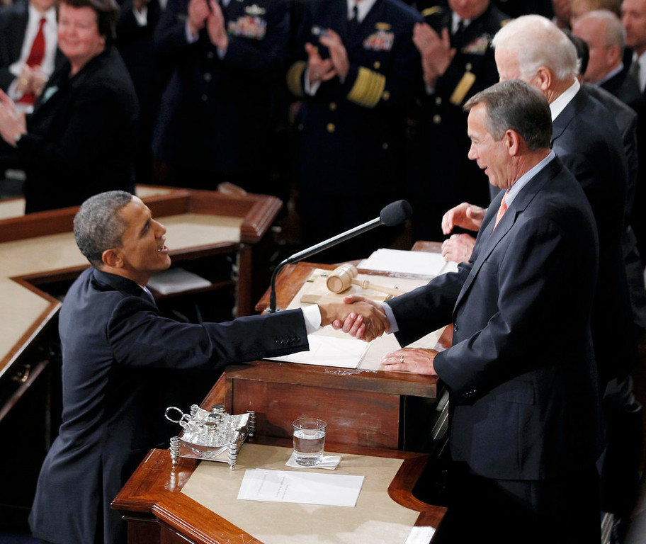 Description of . U.S. President Barack Obama shakes hands with House Speaker John Boehner (R) as he arrives to deliver his State of the Union Speech on Capitol Hill in Washington, February 12, 2013. REUTERS/Jason Reed