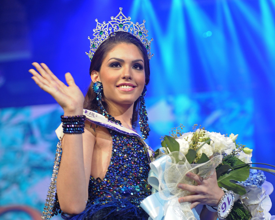 Description of . Marcelo Ohio of Brazil waves after winning the International Queen 2013 Transexual beauty contest in Pattaya on November 1, 2013. Twenty-five contestants from 17 countries competed in Pattaya for the Miss International Queen title.        AFP PHOTO / PORNCHAI  KITTIWONGSAKUL/AFP/Getty Images