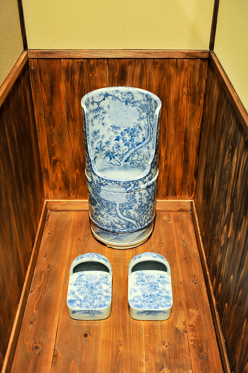 Description of . TOKYO, JAPAN - JULY 01:  An old toilet is displayed during the