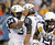 Navy fullback Noah Copeland (34) is congratulated by quarterback Keenan Reynolds (19) after scoring a touchdown against Army during the second quarter of the Army versus Navy NCAA football game in Philadelphia, Pennsylvania, December 8, 2012. REUTERS/Tim Shaffer
