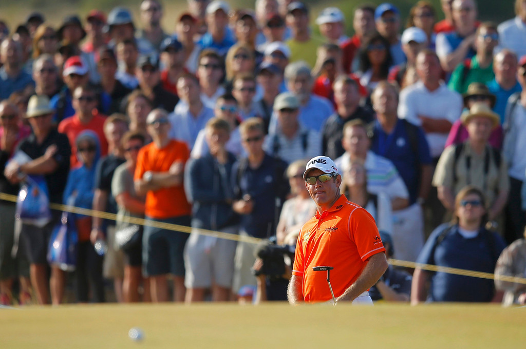 Description of . Lee Westwood of England watches his bogey putt on the 16th green during the third round of the British Open golf Championship at Muirfield in Scotland July 20, 2013. REUTERS/Brian Snyder