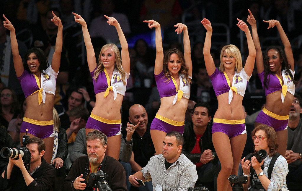 Description of . LOS ANGELES, CA - DECEMBER 25:  The Laker Girls dance squad point to the bench after Tyson Chandler #6 of the New York Knicks (not in photo) fouled out of the game in the fourth quarter during the NBA game between the New York Knicks and the Los Angeles Lakers at Staples Center on December 25, 2012 in Los Angeles, California.  The Lakers defeated the Knicks 100-94. (Photo by Victor Decolongon/Getty Images)