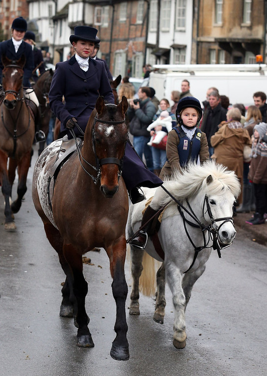 Description of . A young rider with the Avon Vale Hunt, follows the hounds as they ride out for their traditional Boxing Day hunt, on December 26, 2012 in Lacock, England. As hundreds of hunts met today, Environment Secretary Owen Paterson claimed that moves to repeal the ban on hunting with dogs in England and Wales may not happen in 2013, although he insisted it was still the government's intention to give MPs a free vote on lifting the ban.  (Photo by Matt Cardy/Getty Images)