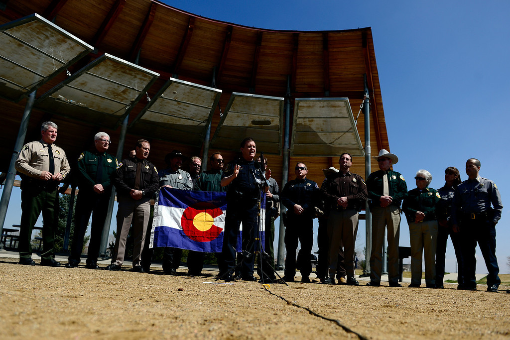 Description of . DENVER, CO - APRIL 3: Larimer County Sheriff Justin Smith speaks to a crowd. Sheriffs from around the state gathered to speak out against gun control before President Barack Obama was set to give a speech at the Denver Police Academy about a mile away. (Photo by AAron Ontiveroz/The Denver Post)