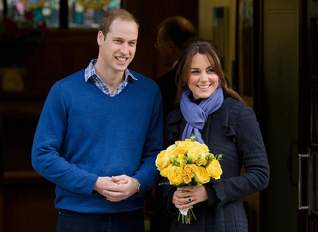 Description of . Britain\'s Prince William, the Duke of Cambridge, (L) poses for pictures with his wife Catherine, Duchess of Cambridge, as they leave the King Edward VII hospital in central London, on December 6, 2012. Prince William\'s pregnant wife Catherine left a London hospital on Thursday, four days after she was admitted for treatment for acute morning sickness.  LEON NEAL/AFP/Getty Images