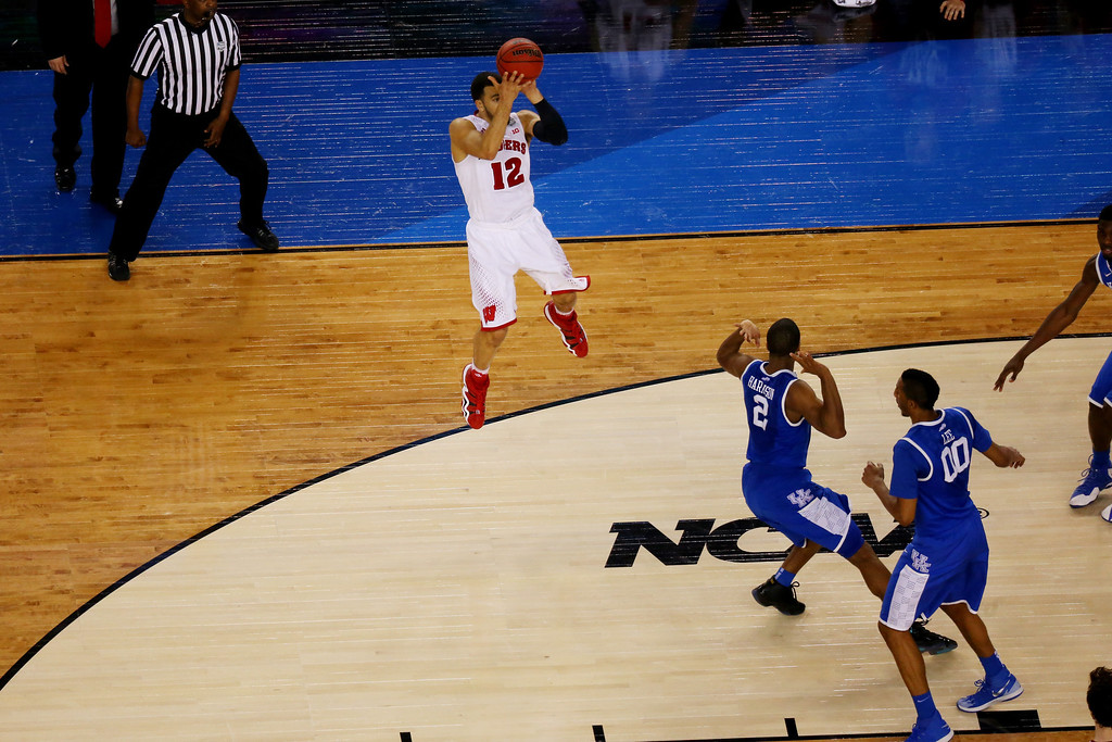 Description of . ARLINGTON, TX - APRIL 05: Traevon Jackson #12 of the Wisconsin Badgers misses a shot at the buzzer against the Kentucky Wildcats during the NCAA Men's Final Four Semifinal at AT&T Stadium on April 5, 2014 in Arlington, Texas. The Kentucky Wildcats defeated the Wisconsin Badgers 74-73. (Photo by Ronald Martinez/Getty Images)