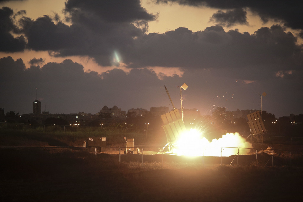 Description of . The Iron Dome air-defense system fires to intercept a rocket over the city of Ashdod on July 16, 2014 in Ashdod,Israel. An Egyptian ceasefire proposal was yesterday refused by Hamas, who continued their missile bombardment on Israel. Israel has today issued a warning to 100,00 residents of northern Gaza to evacuate their homes as it continues with planned airstrikes as part of operation 'Protective Edge'. Israeli Prime Minister Benjamin Netanyahu said he had 'no choice' but to intensify the military operation in light of the refusal to ceasefire terms from Hamas officials.  (Photo by Ilia Yefimovich/Getty Images)