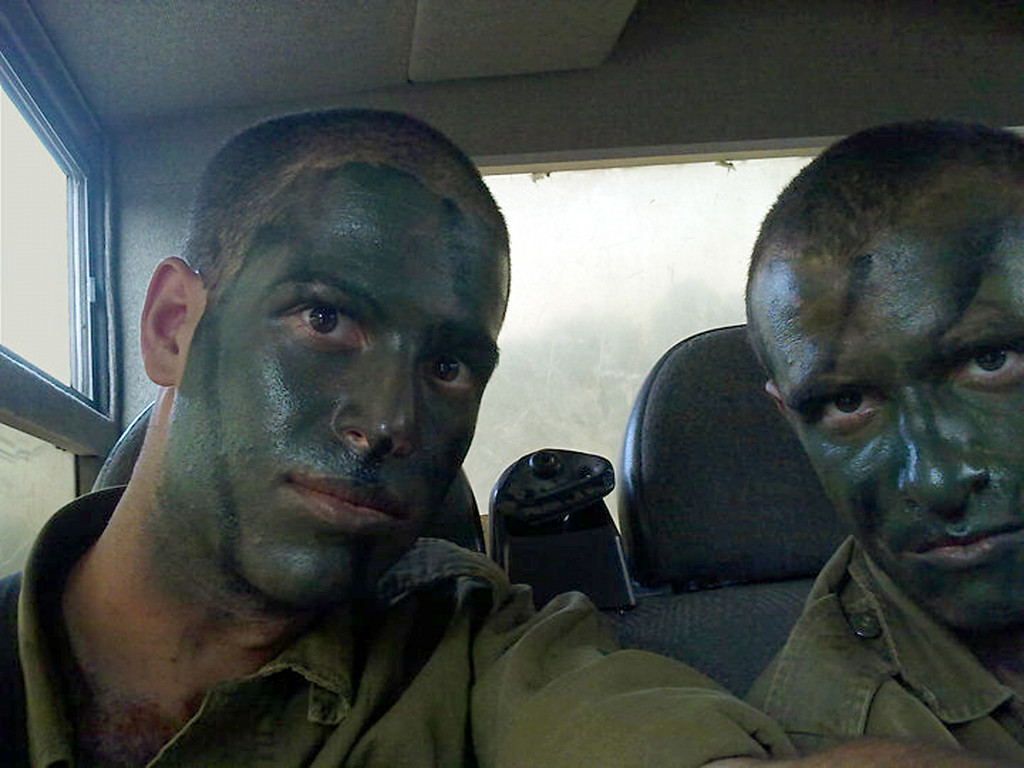 Description of . This December 2010 photo provided by Mike Fishbein shows Fishbein, left, a U.S.-born soldier from Los Angeles, and fellow American Ilan Benjamin, both members of the Israel Defense Forces. The two Americans killed in fighting in the Gaza Strip followed in the footsteps of scores of Jews from around the world who have volunteered to fight for Israel. Israel calls them the lone soldiers: They are men and women in the prime of their lives who have left their parents and often comfortable lives behind in places like Sydney, London, Los Angeles and elsewhere to join the IDF, marching in the desert and taking up arms to defend the Jewish state. There are about 2,000 lone soldiers currently serving in the Israeli military. (AP Photo/Courtesy Mike Fishbein)