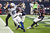 Reggie Wayne #87 of the Indianapolis Colts completes a pass in the endzone as he beats Danieal Manning #38 and Quintin Demps #27 of the Houston Texans on the play in the first half at Reliant Stadium on December 16, 2012 in Houston, Texas. The play was negated by a penalty.  (Photo by Bob Levey/Getty Images)