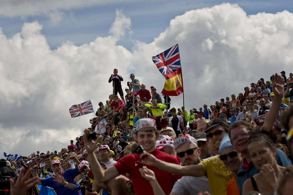 Description of . Supporters are pictured along the road during the 201 km second stage of the 101th edition of the Tour de France cycling race on July 6, 2014 between York and Sheffield, northern England.  AFP PHOTO / JEFF PACHOUDJEFF PACHOUD/AFP/Getty Images