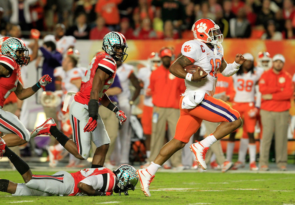 Description of . MIAMI GARDENS, FL - JANUARY 03:  Tajh Boyd #10 of the Clemson Tigers runs for a touchdown in the first half against the Ohio State Buckeyes during the Discover Orange Bowl at Sun Life Stadium on January 3, 2014 in Miami Gardens, Florida.  (Photo by Chris Trotman/Getty Images)
