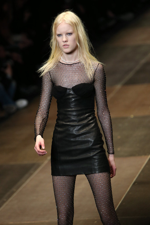 Description of . A model presents a creation for Saint Laurent's Fall/Winter 2013-2014 ready to wear collection, in Paris, Monday, March, 4, 2013. (AP Photo/Thibault Camus)