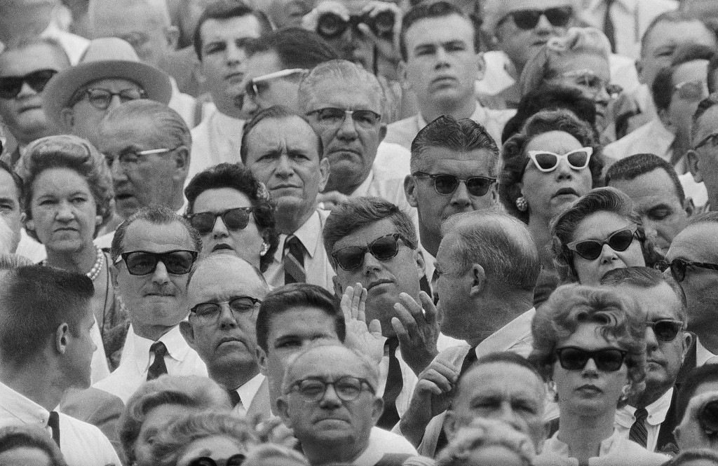 Description of . President-elect Kennedy sits on the Navy side of the Orange Bowl about halfway up in the stands near the 50-yard line on Jan. 2, 1961, as he views the Navy-Missouri football game.  Missouri won 21-14. Associated Press file