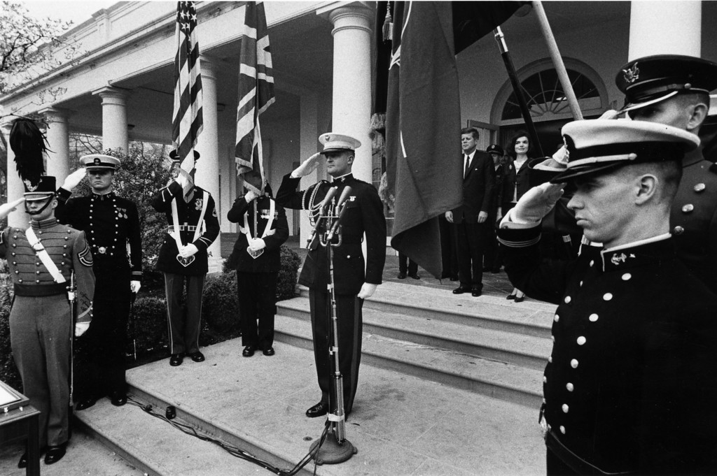 Description of . Kennedy and wife Jackie stand at the top of a flight of stairs outside the White House during a ceremony proclaiming Sir Winston Churchill an honorary citizen of the United States on April 10, 1963. Churchill couldn't attend, but a letter from him was read by his son, Randolph, in which he said that it was an honor without parallel, which he accepted with deep gratitude affection. During the ceremony Kennedy said Churchill was