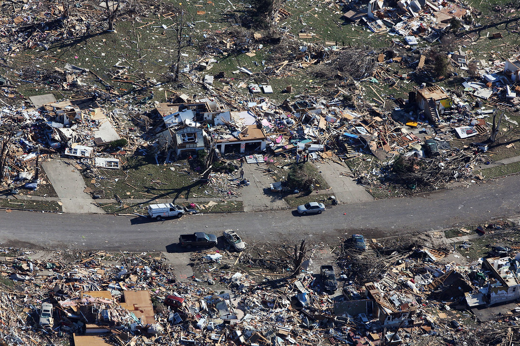 Description of . Tornado damaged homes are seen on November 18, 2013 in Washington, Illinois. According to reports the tonado that ripped across Washington, Illinois has been preliminary classified as an EF-4. A fast-moving storm system that spawned multiple tornadoes which touched down across the Midwest, leaving behind a path of destruction in 12 states and killing at least five.  (Photo by Tasos Katopodis/Getty Images)