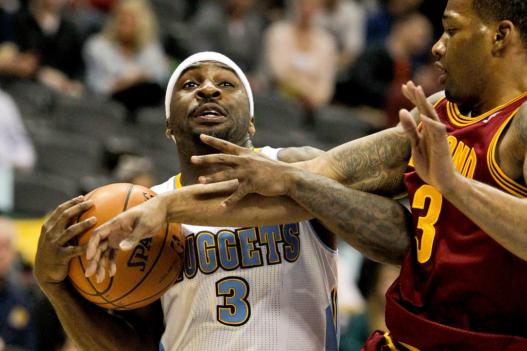 Description of . Denver Nuggets' Ty Lawson (3) is fouled by Cleveland Cavaliers' Dion Waiters (3) during the first quarter of an NBA basketball game Friday, Jan. 11, 2013, in Denver. (AP Photo/Barry Gutierrez)