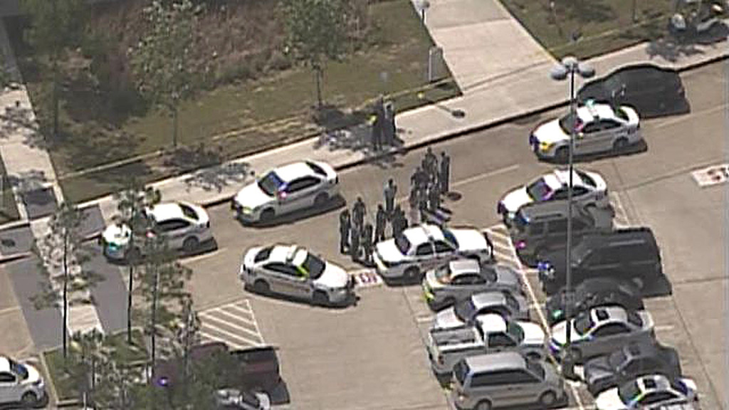 Description of . Law enforcement personnel gather near the scene of a mass stabbing at the Cy-Fair campus of Lone Star College in northwest Houston, as seen in this still image from video courtesy of KPRC-TV April 9, 2013.REUTERS/KPRC-TV
