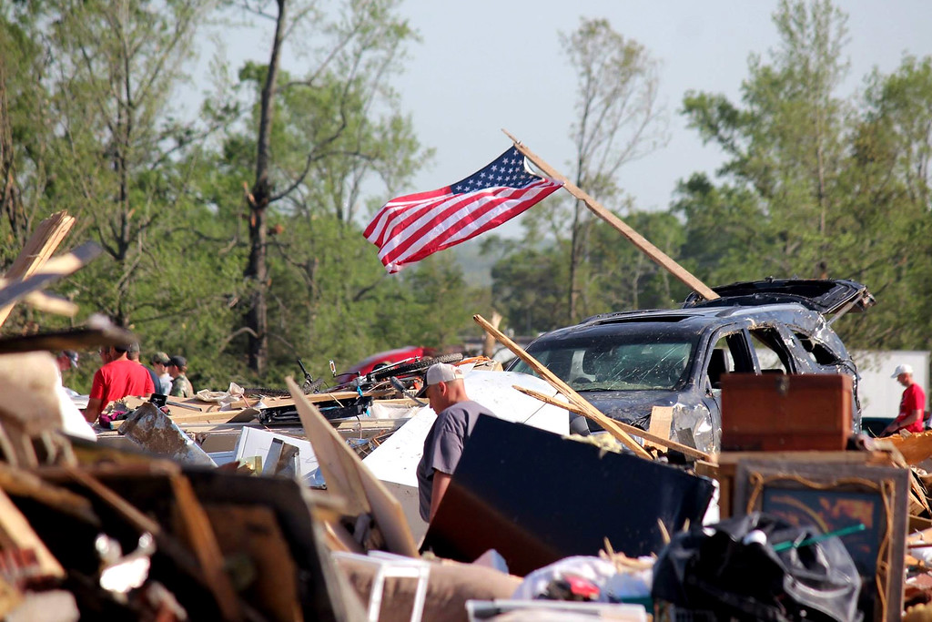 Description of . In this handout provided by the Arkansas National Guard, people walk amongst the rubble following a deadly tornado April 28, 2014 in Vilonia, Arkansas.  (Photo by Arkansas National Guard via Getty Images)