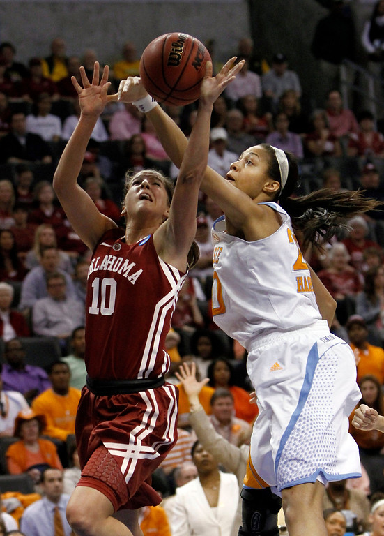 Description of . Oklahoma's Morgan Hook (10) drives to the basket as Tennessee's Isabelle Harrison (20) defends during a regional semifinal game in the women's NCAA college basketball tournament in Oklahoma City, Sunday, March 31, 2013.  (AP Photo/Alonzo Adams)