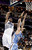 Charlotte Bobcats' Bismack Biyombo (0) muscles Denver Nuggets' Kosta Koufos (41) out of the way as he prepares to shoot during the first half of an NBA basketball game in Charlotte, N.C., Saturday, Feb. 23, 2013. (AP Photo/Bob Leverone)
