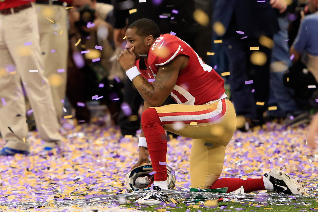 Description of . Perrish Cox #20 of the San Francisco 49ers kneels down among the confetti following their loss to the Baltimore Ravens during Super Bowl XLVII at the Mercedes-Benz Superdome on February 3, 2013 in New Orleans, Louisiana. The Ravens defeated the 49ers 34-31. (Photo by Jamie Squire/Getty Images)